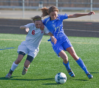 Bexley High Schools #13 Mackenzie Bolon and Middletown Bishop Fenwick High School's #6 Kelci McHugh vie for control of the ball in the second period of play in the OHSAA Girls Division II Regional Final Soccer Tournament held Saturday afternoon November 7, 2009 at the Hilliard Bradley HIgh School. Bexley won 2-0. (Photo by James D. DeCamp 614-462-8027)
