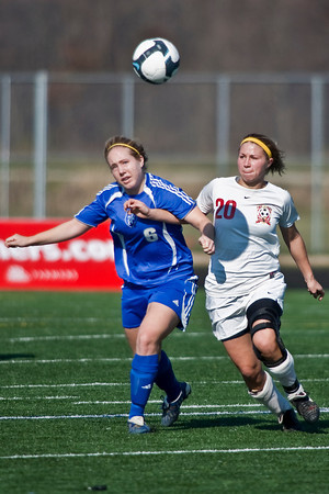 Bexley High Schools #6 Rachael Crane and Middletown Bishop Fenwick High School's #20 Sydney Neal in the OHSAA Girls Division II Regional Final Soccer Tournament held Saturday afternoon November 7, 2009 at the Hilliard Bradley HIgh School. Bexley won 2-0. (Photo by James D. DeCamp 614-462-8027)