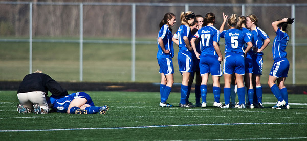 Bexley High Schools team gathers as coaches and trainers look at #6 Rachael Crane after she collided with Middletown Bishop Fenwick High School's #2 Meghan Blank in the second period of play in the OHSAA Girls Division II Regional Final Soccer Tournament held Saturday afternoon November 7, 2009 at the Hilliard Bradley HIgh School. Bexley won 2-0. (Photo by James D. DeCamp 614-462-8027)