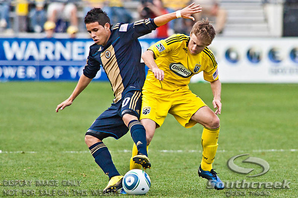 Philadelphia Union's Midfielder Roger Torres (#20) and Columbus Crew's Midfielder Brian Carroll (#16) vie for control of the ball in the first period of play at the Columbus Crew Stadium in Columbus, Ohio, Sunday October 24, 2010. The Columbus Crew defeated Philadelphia Union 3-1 in MLS Regular Season game.  (© James D. DeCamp / Southcreek Global Media)  | All Rights Reserved  | http://www.southcreekglobal.com | For all sales contact: sales@southcreekglobal.com | 1-800-934-5030