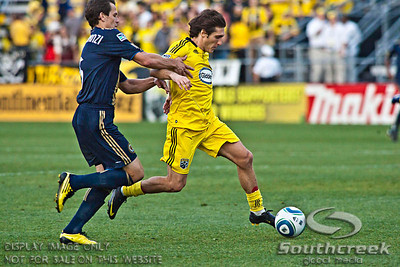 Philadelphia Union's Midfielder Miglioranzi Miglioranzi (#6) fights for control of the ball with Columbus Crew's Midfielder/Forward Guillermo Barros Schelotto (#7) in the second period of play at the Columbus Crew Stadium in Columbus, Ohio, Sunday October 24, 2010. The Columbus Crew defeated the Philadelphia Union 3-1 in their MLS regular-season finale.  (© James D. DeCamp / Southcreek Global Media)  | All Rights Reserved  | http://www.southcreekglobal.com | For all sales contact: sales@southcreekglobal.com | 1-800-934-5030