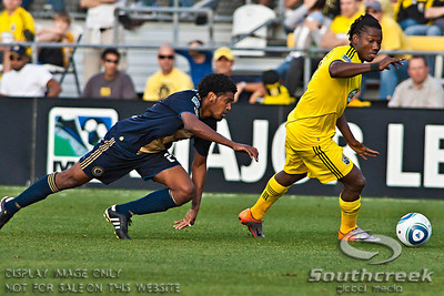 Philadelphia Union's Defender/Midfielder Sheanon Williams (#25) falls short of catching Columbus Crew's Forward Andrés Mendoza (#10) as he controls the ball in the second period of play at the Columbus Crew Stadium in Columbus, Ohio, Sunday October 24, 2010. The Columbus Crew defeated the Philadelphia Union 3-1 in their MLS regular-season finale.  (© James D. DeCamp / Southcreek Global Media)  | All Rights Reserved  | http://www.southcreekglobal.com | For all sales contact: sales@southcreekglobal.com | 1-800-934-5030