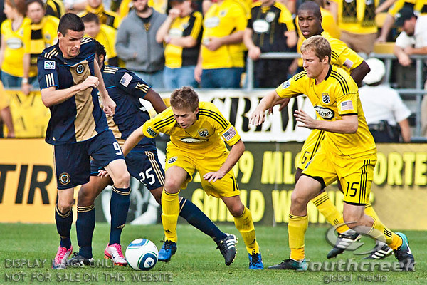Philadelphia Union's Forward Sebastien Le Toux (#9) gets the ball away from Columbus Crew's Midfielder Brian Carroll (#16) in the second period of play at the Columbus Crew Stadium in Columbus, Ohio, Sunday October 24, 2010. The Columbus Crew defeated the Philadelphia Union 3-1 in their MLS regular-season finale.  (© James D. DeCamp / Southcreek Global Media)  | All Rights Reserved  | http://www.southcreekglobal.com | For all sales contact: sales@southcreekglobal.com | 1-800-934-5030