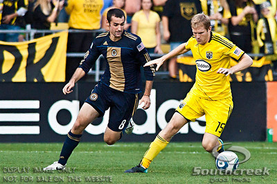 Philadelphia Union's Midfielder Andrew Jacobson (#8) and Columbus Crew's Midfielder Kevin Burns (#15) in the second period of play at the Columbus Crew Stadium in Columbus, Ohio, Sunday October 24, 2010. The Columbus Crew defeated the Philadelphia Union 3-1 in their MLS regular-season finale.  (© James D. DeCamp / Southcreek Global Media)  | All Rights Reserved  | http://www.southcreekglobal.com | For all sales contact: sales@southcreekglobal.com | 1-800-934-5030