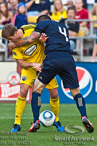 Philadelphia Union's Defender Danny Califf (#4) and Columbus Crew's Midfielder/Forward Robbie Rogers (#18) vie for control of the ball in the second period of play at the Columbus Crew Stadium in Columbus, Ohio, Sunday October 24, 2010. The Columbus Crew defeated the Philadelphia Union 3-1 in their MLS regular-season finale.  (© James D. DeCamp / Southcreek Global Media)  | All Rights Reserved  | http://www.southcreekglobal.com | For all sales contact: sales@southcreekglobal.com | 1-800-934-5030