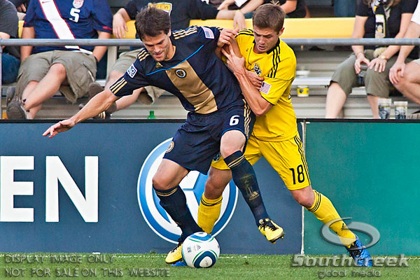 Philadelphia Union's Midfielder Stefani Miglioranzi (#6) and Columbus Crew's Midfielder/Forward Robbie Rogers (#18) vie for control of the ball in the second period of play at the Columbus Crew Stadium in Columbus, Ohio, Sunday October 24, 2010. The Columbus Crew defeated the Philadelphia Union 3-1 in their MLS regular-season finale.  (© James D. DeCamp / Southcreek Global Media)  | All Rights Reserved  | http://www.southcreekglobal.com | For all sales contact: sales@southcreekglobal.com | 1-800-934-5030