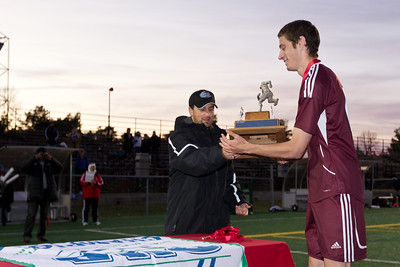 Garret McConville accepting the OUA Championship trophy