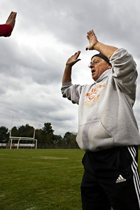 Big Walnut High School's Girls Soccer Coach Jim Reardon prepares to give a high five to one of his players before the first period of play at Olentangy Orange High School Tuesday night September 6, 2011. (©2011 James D. DeCamp | 614-367-6366 | http://www.JamesDeCamp.com)