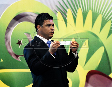 "Brazil's former soccer player Ronaldo holds up the name ""Spain"" at the preliminary draw for the 2014 World Cup, Rio de Janeiro, Brazil, July 30, 2011. The 2014 World Cup took shape Saturday as the qualifying draw laid out each nation's path to securing a spot in the tournament in three years' time. The draw determined the layout of the qualifying groups for Africa; North, Central America and the Caribbean; Asia; Europe; and Oceania. (Austral Foto/Renzo Gostoli)"