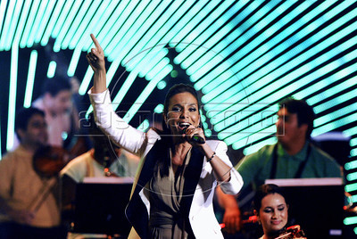 Brazilian singer Ivete Sangalo sings at the Preliminary Draw of the 2014 FIFA World Cup Brazil in Rio de Janeiro, Brazil, July 30, 2011. The 2014 World Cup took shape Saturday as the qualifying draw laid out each nation's path to securing a spot in the tournament in three years' time. The draw determined the layout of the qualifying groups for Africa; North, Central America and the Caribbean; Asia; Europe; and Oceania. (Austral Foto/Renzo Gostoli)
