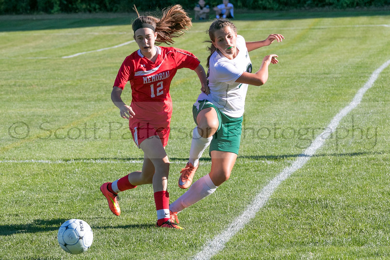 Manchester Memorial's Julia Lanoie and Dover's Maggie Casey battle for the ball during the girls varsity soccer game at Dover High School Tuesday. Photo by Scott Patterson/Fosters.com