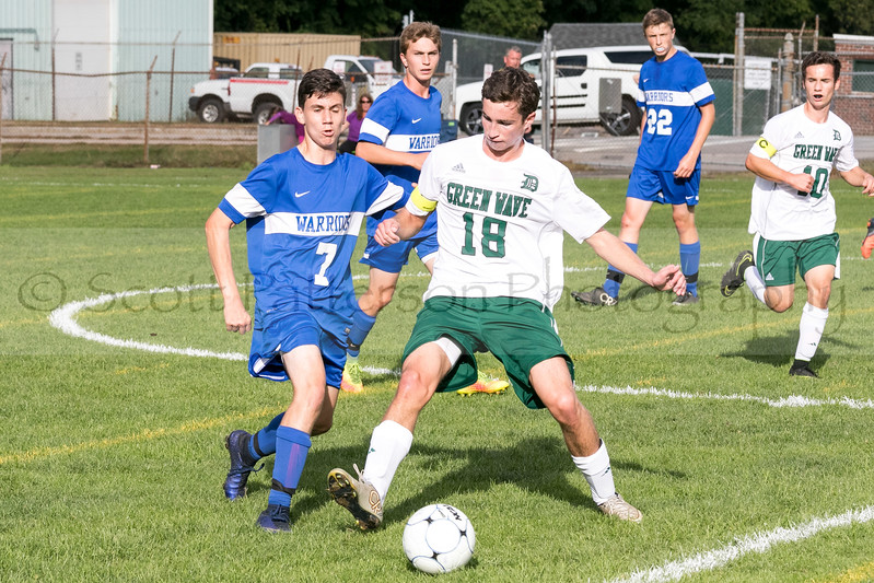 Dover's Michael Fraser defends against Winnacunnet's Patrick Cotter during Division I Varsity Boys Soccer in Dover on Tuesday. Photo by Scott Patterson/Fosters.com