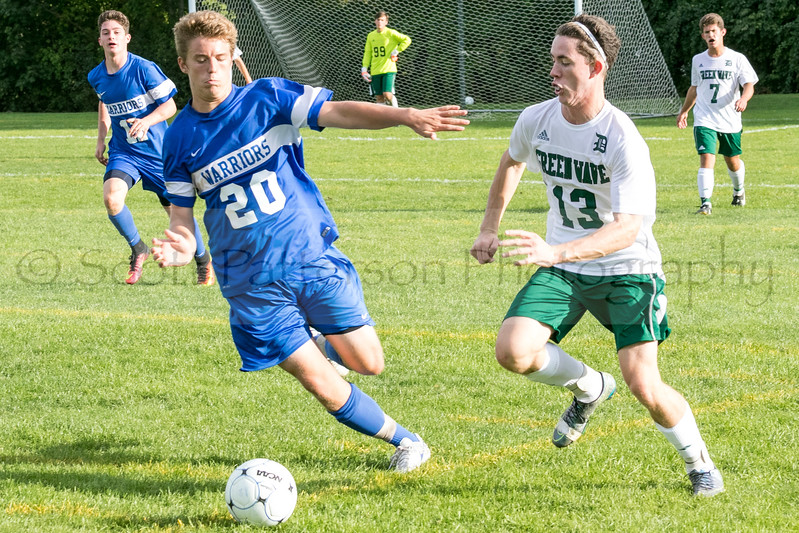 Winnacunnet's Kevin Gagnon and Dover's Sean O'Doherty battle for a loose ball during Division I Varsity Boys Soccer in Dover on Tuesday. Photo by Scott Patterson/Fosters.com