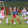 Washington Spirit forward Katie Stengel passes the ball away from UVA's Alexis Shaffer (8) and Jasmine Wright (13)