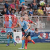 Sky Blue defender Kelly O'Hara and Spirit defender Shelina Zadorsky tangle up after Zadorsky heads the ball away from O'Hara.