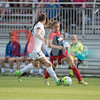 Estefania Banini a forward for the Washington Spirit focuses on the ball as she deftly moves it past FCKC defender Brittany Taylor.