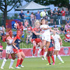 Washington Spirit midfielder Joanna Lohman wins a 50/50 header against FCKC midfielder Lo'eau LaBonta