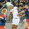WNYF forward Jessica McDonald heads the ball away from Spirit defender and Olympian Ali Krieger.