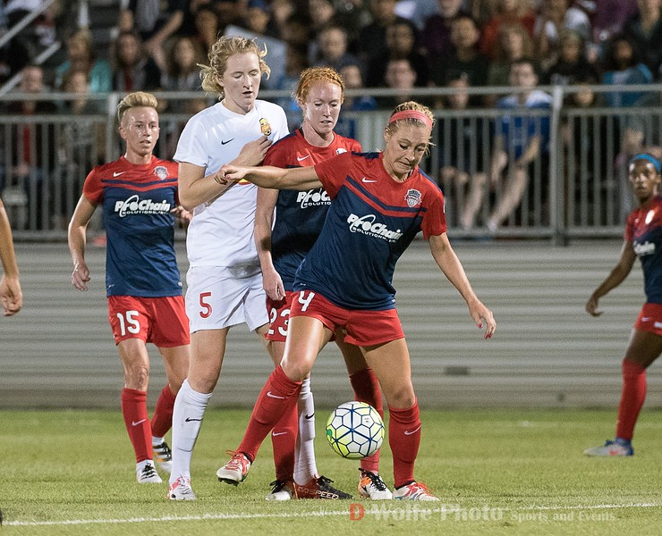 Spirit defender Megan Oyster backed by Tori Huster settles the ball away from WNYF Samantha Mewis keeeping Samantha from scoring on this attack.