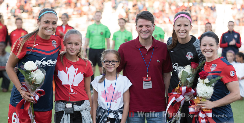 The Canadian Womens Soccer Bronze Olympians  with the Canadian Deputy Ambassador to the USA and his daughters.   From left to right, Shelina Zadorsky, the Ambassadors daughters Isabelle and Elliott,  Deputy Ambassador Denis Stevens, Stephanie Labbé, and Diana Matheson.