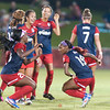 Spirit forward Cheyna Williams (left) and forward Crystal Dunn celebrate Dunn's goal with a little bit of dancing on the field as Caprice Dydesco and Estelle Johnson watch.