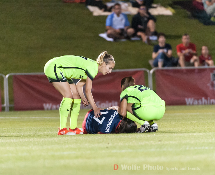 First to Cali's side after her injury dropped her to the ground in pain.