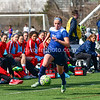 The lot of the Washington SPirit bench and coaching staff have their attention focused on  forward Laura Freigang from Penn State as she makes run down the team side sidelines.