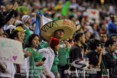 A Mexico fan sports a large sombrero during Soccer action between Bosnia-Herzegovina and Mexico.  Mexico defeated Bosnia-Herzegovina 2-0 in the game at the Georgia Dome in Atlanta, GA.
