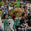 A Mexico fan sports a large sombrero during Soccer action between Bosnia-Herzegovina and Mexico.  Mexico defeated Bosnia-Herzegovina 2-0 in the game at the Georgia Dome in Atlanta, GA.