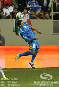 Bosnia-Herzegovina's Midfielder Sejad Salihovic (#15) heads the ball in Soccer action between Bosnia-Herzegovina and Mexico.  Mexico defeated Bosnia-Herzegovina 2-0 in the game at the Georgia Dome in Atlanta, GA.