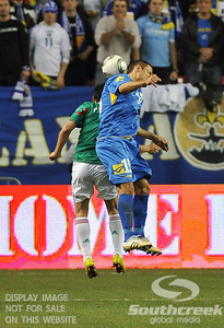 Bosnia-Herzegovina's Midfielder Sejad Salihovic (#15) goes for a header during Soccer action between Bosnia-Herzegovina and Mexico.  Mexico defeated Bosnia-Herzegovina 2-0 in the game at the Georgia Dome in Atlanta, GA.