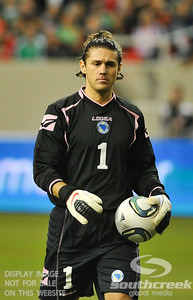 Bosnia-Herzegovina's Goalkeeper Kenan Hasagic (#1) walks the ball back towards the goal to prepare for a goalie kick during Soccer action between Bosnia-Herzegovina and Mexico.  Mexico defeated Bosnia-Herzegovina 2-0 in the game at the Georgia Dome in Atlanta, GA.