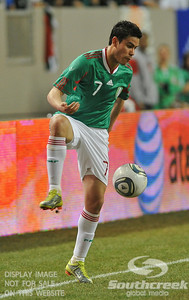 Mexico's Forward Pablo Barrera (#7) stops the ball from going out of bounds during Soccer action between Bosnia-Herzegovina and Mexico.  Mexico defeated Bosnia-Herzegovina 2-0 in the game at the Georgia Dome in Atlanta, GA.