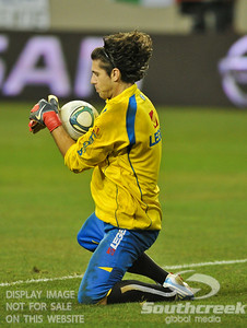 Bosnia-Herzegovina's Goalkeeper Kenan Hasagic (#1) catches a goal attempt in warmups before Soccer action between Bosnia-Herzegovina and Mexico.  Mexico defeated Bosnia-Herzegovina 2-0 in the game at the Georgia Dome in Atlanta, GA.