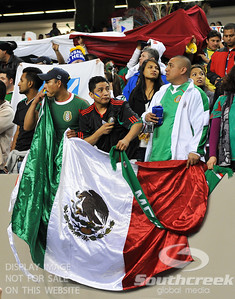 Fans of Mexico proudly display the countries flag during Soccer action between Bosnia-Herzegovina and Mexico.  Mexico defeated Bosnia-Herzegovina 2-0 in the game at the Georgia Dome in Atlanta, GA.