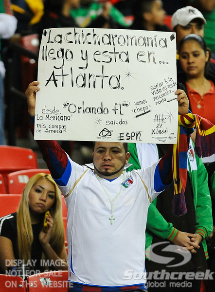 A fan holds up a sign during Soccer action between Bosnia-Herzegovina and Mexico.  Mexico defeated Bosnia-Herzegovina 2-0 in the game at the Georgia Dome in Atlanta, GA.