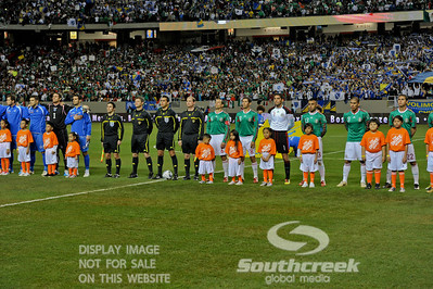 Both teams line up with the referees before Soccer action between Bosnia-Herzegovina and Mexico.  Mexico defeated Bosnia-Herzegovina 2-0 in the game at the Georgia Dome in Atlanta, GA.