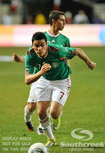 Mexico's Forward Pablo Barrera (#7) gives chase on the ball during Soccer action between Bosnia-Herzegovina and Mexico.  Mexico defeated Bosnia-Herzegovina 2-0 in the game at the Georgia Dome in Atlanta, GA.
