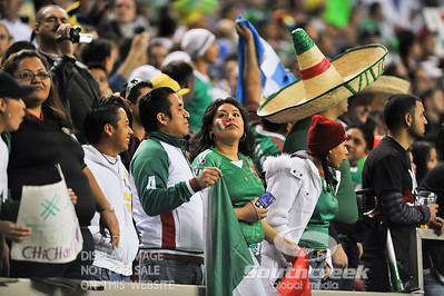A fan of Mexico looks up at the scoreboard during Soccer action between Bosnia-Herzegovina and Mexico.  Mexico defeated Bosnia-Herzegovina 2-0 in the game at the Georgia Dome in Atlanta, GA.