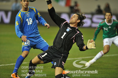 Bosnia-Herzegovina's Midfielder Haris Medunjanin (#18) watches as Bosnia-Herzegovina's Goalkeeper Kenan Hasagic (#1) makes a save on a shot during Soccer action between Bosnia-Herzegovina and Mexico.  Mexico defeated Bosnia-Herzegovina 2-0 in the game at the Georgia Dome in Atlanta, GA.