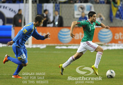 Bosnia-Herzegovina's Midfielder Haris Medunjanin (#18) chases after Mexico's Forward Pablo Barrera (#7) during Soccer action between Bosnia-Herzegovina and Mexico.  Mexico defeated Bosnia-Herzegovina 2-0 in the game at the Georgia Dome in Atlanta, GA.