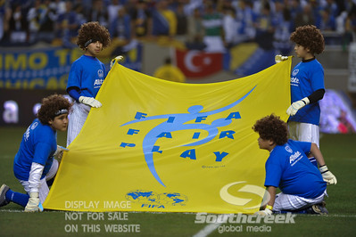 Young boys hold the FIFA sign before Soccer action between Bosnia-Herzegovina and Mexico.  Mexico defeated Bosnia-Herzegovina 2-0 in the game at the Georgia Dome in Atlanta, GA.