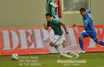 Bosnia-Herzegovina's Midfielder Sejad Salihovic (#15) gives chase to Mexico's Forward Pablo Barrera (#7) in Soccer action between Bosnia-Herzegovina and Mexico.  Mexico defeated Bosnia-Herzegovina 2-0 in the game at the Georgia Dome in Atlanta, GA.
