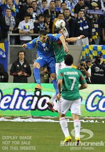 Bosnia-Herzegovina's Defencer Emir Spahic (#4) goes for a header during Soccer action between Bosnia-Herzegovina and Mexico.  Mexico defeated Bosnia-Herzegovina 2-0 in the game at the Georgia Dome in Atlanta, GA.
