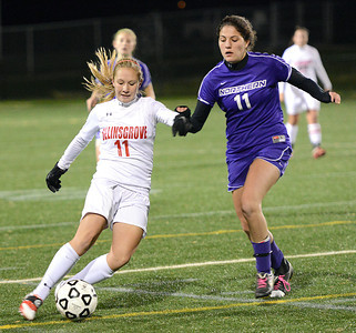 Selinsgrove Seals' Lacey Trautman pushes the ball past Northern Polarbears' Shea Regan during the Class AA state playoff game in Loyalsock on Tuesday night. The Seals lost 2-1.
