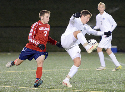 Lewisburg Green Dragons' Daniel Cole traps the ball away from Coughlin Crusaders' Travis Keil during the Class AA state playoff game on Tuesday night in Loyalsock. The Green Dragons beat the Crusaders 1-0.