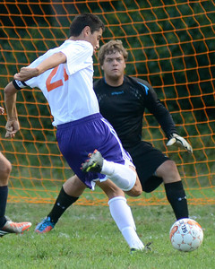 Danville's Andrew Smith lines up his shot against Mifflinburg's goalie, , scoring to help the Ironmen win Wednesday Sept. 5, 2012 in Danville.