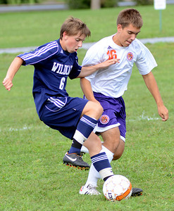 Mifflinburg's Gordy DeFrancis and Danville's Wesley Yeich battle for the ball during their game Wednesday Sept. 5, 2012 in Danville.