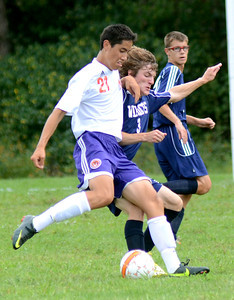 Danville's Andrew Smith and Mifflinburg's Derek Stahl battle for the ball during their game Wednesday Sept. 5, 2012 in Danville.