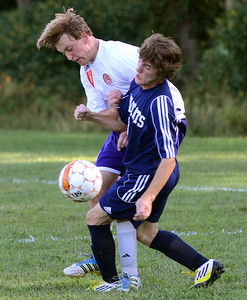 Danville's Kyle Knotts and Mifflinburg's Derek Stahl get tangled up during their game Wednesday Sept. 5, 2012 in Danville.